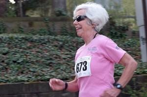 Woman running a 5K outside.
