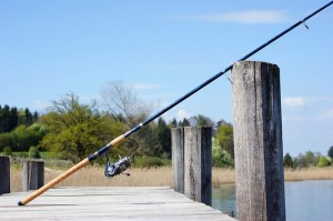 fishing rod on a waterway boardwalk