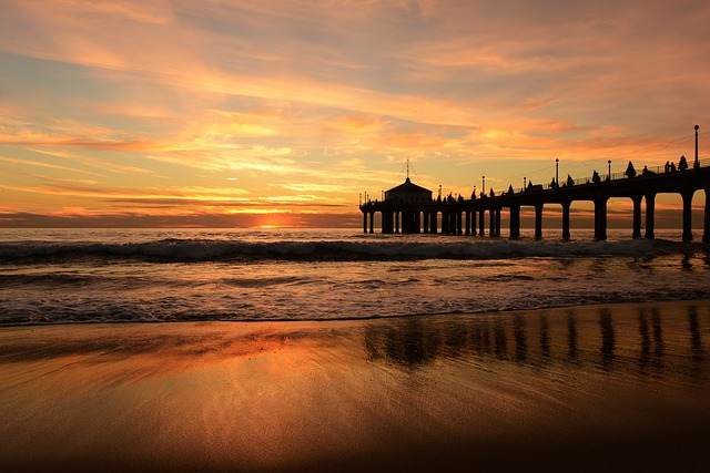 pier over the ocean at sunset