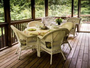 southern screened porch with wicker furniture