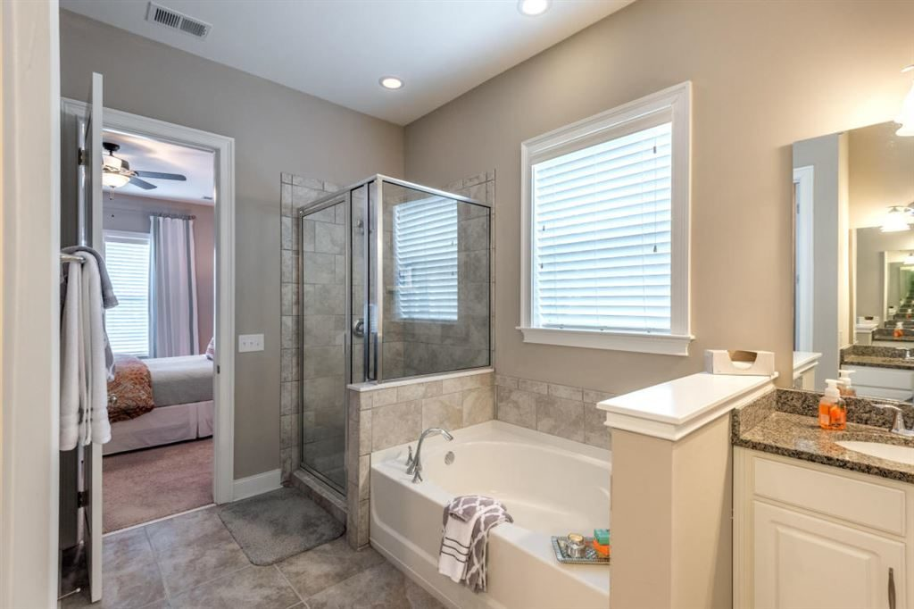 Large master bath with huge tub and glass shower.